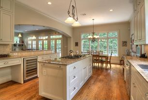Traditional Kitchen with Simple granite counters, Wine refrigerator, Flush, U-shaped, flush light, Flat panel cabinets