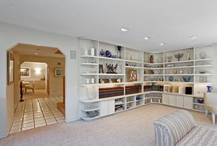 Traditional Living Room with Built-in bookshelf, Sunken living room, Carpet