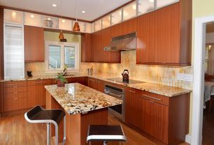 Contemporary Kitchen with full backsplash, wall oven, L-shaped, electric range, drop-in sink, Limestone Tile, can lights