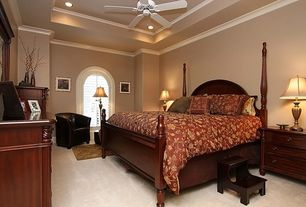 Traditional Guest Bedroom with Arched window, Crown molding, Standard height, Ceiling fan, can lights, Carpet
