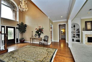 Traditional Entryway with High ceiling, Hardwood floors, Columns, Chandelier, Arched window, Transom window, French doors