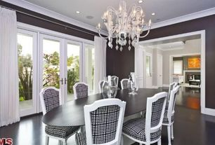 Contemporary Dining Room with Medium Blown Glass Pillar Hurricane Candle Holder, French doors, Chandelier, Concrete floors