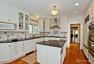 Traditional Kitchen with Standard height, Large Ceramic Tile, full backsplash, U-shaped, flush light, Kitchen island