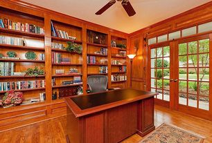 Traditional Home Office with Transom window, French doors, Crown molding, Laminate floors, Built-in bookshelf, Ceiling fan