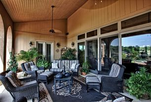 Traditional Porch with exterior tile floors, Wrap around porch, sliding glass door, exterior concrete tile floors