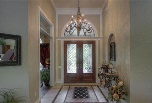 Traditional Entryway with Glass panel door, Concrete tile , Arched window, Chandelier, High ceiling, Transom window
