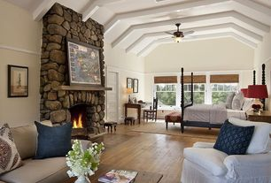 Eclectic Master Bedroom with Wainscotting, Crown molding, Transom window, stone fireplace, Hardwood floors, specialty door