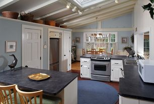 Cottage Kitchen with Framed Partial Panel, Soapstone counters, Soapstone, Breakfast bar, partial backsplash, drop-in sink