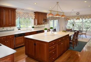 Country Kitchen with Hardwood floors, Chandelier, Breakfast nook, Casement, L-shaped, Framed Partial Panel, Drop-in sink