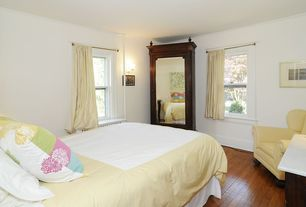 Traditional Guest Bedroom with Wall sconce, Crown molding, Standard height, Hardwood floors, double-hung window