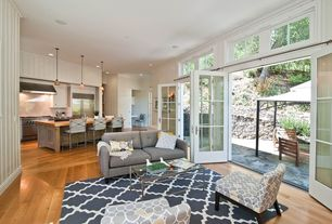 Contemporary Living Room with Laminate floors, Transom window, Pendant light, Carpet, French doors