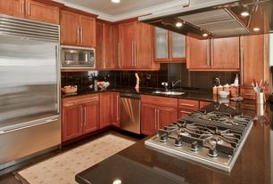 Modern Kitchen with Glass panel, Hardwood floors, Soapstone counters, Undermount sink, Galley, Crown molding