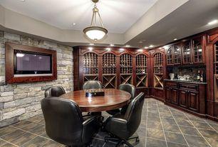 Traditional Game Room with flush light, limestone floors, Standard height, Built-in bookshelf, can lights