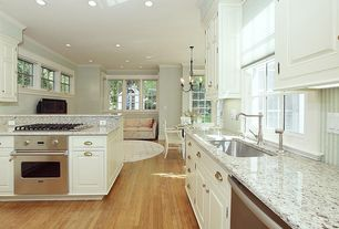 "Traditional Kitchen with Viking 30"" electric single select oven - veso, interior wallpaper, Undermount sink, Raised panel"