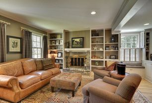 Traditional Living Room with Hardwood floors, specialty window, can lights, brick fireplace, Standard height, Fireplace
