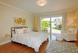 Contemporary Guest Bedroom with Hardwood floors, Crown molding, flush light