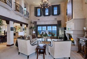 Mediterranean Living Room with travertine floors, French doors, Chandelier, Loft, Quoizel La Parra 18 Light Chandelier