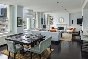 Contemporary Great Room with Columns, Laminate floors, Carpet, Crown molding, Standard height, Built-in bookshelf, can lights
