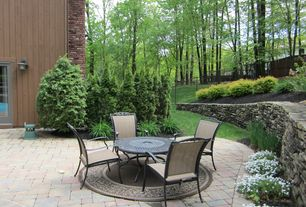 Traditional Patio with Raised beds, Fence, exterior brick floors, Pathway