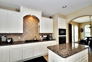 Traditional Kitchen with Travertine, High ceiling, Dura Supreme Cabinetry Hampton Classic Panel, Kitchen island, One-wall
