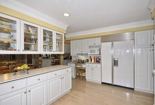 Country Kitchen with full backsplash, Raised panel, Glass panel, Built In Panel Ready Refrigerator, can lights, L-shaped
