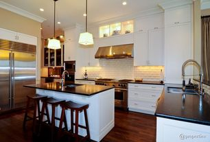 Traditional Kitchen with Undermount sink, U-shaped, Crown molding, Flat panel cabinets, Kitchen island, Stone Tile, Flush