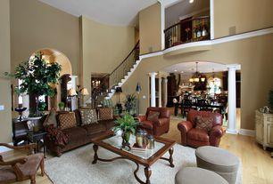 Mediterranean Living Room with Crown molding, High ceiling, Hardwood floors, Carpet