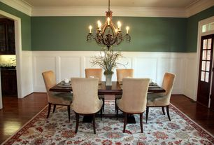 Traditional Dining Room with Transom window, Glass panel door, Hardwood floors, Chandelier, Crown molding, Wainscotting