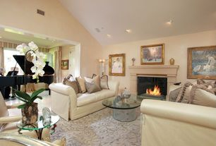 Traditional Living Room with Casement, insert fireplace, six panel door, Fireplace, can lights, Cathedral ceiling