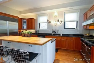 Modern Kitchen with Inset cabinets, Hardwood floors, Glass panel, Breakfast bar, U-shaped, Flat panel cabinets