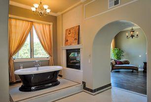 Mediterranean Master Bathroom with Nickel cabinet hardware, Casement, ceramic tile floors, High ceiling, painted walls