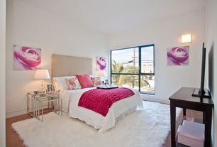 Contemporary Guest Bedroom with World market linen loran headboard, Eurway Pasos Nesting Tables, Wall sconce, Hardwood floors