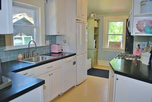 Cottage Kitchen with Soapstone counters, Built In Panel Ready Refrigerator, High ceiling, electric cooktop, Flush, dishwasher