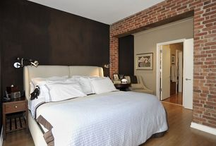 Contemporary Guest Bedroom with interior brick, Hardwood floors
