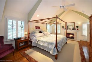 Cottage Guest Bedroom with High ceiling, Hardwood floors, Ceiling fan