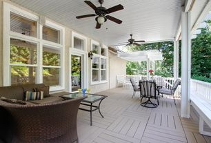 Modern Porch with exterior tile floors, French doors, Transom window, Trellis, Wrap around porch