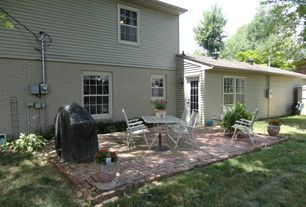 Traditional Patio with exterior brick floors, Outdoor kitchen, French doors
