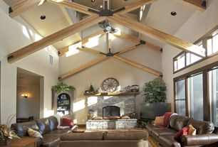Eclectic Living Room with brick fireplace, Exposed beam, Ceiling fan, Laminate floors, can lights, Casement, Fireplace