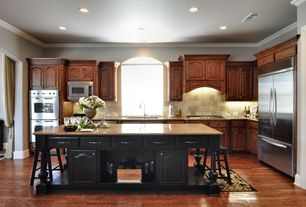 Traditional Kitchen with Custom hood, Double wall oven (stainless steel), Travertine subway tile, Crown molding, Stone Tile