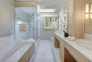 Modern Full Bathroom with Double sink, drop in bathtub, can lights, Bathtub, Inset cabinets, Skylight, Shower, Crown molding