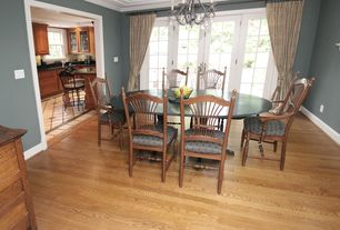 Traditional Dining Room with Hardwood floors, French doors, Chandelier, Standard height, Crown molding