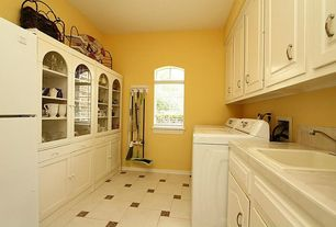Traditional Laundry Room with Built-in bookshelf, Arched window, High ceiling