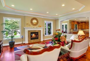 Traditional Living Room with French doors, Crown molding, Hardwood floors