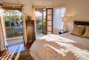 Modern Guest Bedroom with Balcony, Laminate floors, French doors, Carpet