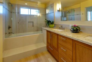 Contemporary Full Bathroom with rectangular mirror, drop in bathtub, Simple granite counters, frameless showerdoor, Frameless