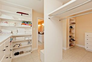 Modern Closet with Crown molding, Standard height, Built-in bookshelf, complex granite floors