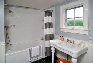 Traditional Full Bathroom with Crown molding, Vintage tub & bath strom plumbing console sink with legs, Wainscotting