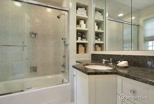 Modern 3/4 Bathroom with tiled wall showerbath, Undermount sink, Built-in bookshelf, Complex granite counters, Concrete tile
