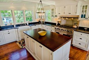 Traditional Kitchen with Circa lighting hurricane lamp pendant light, Wood counters, DuraSupreme Mullion Pattern #1, L-shaped