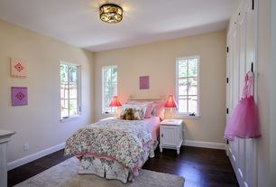 Traditional Kids Bedroom with Built-in bookshelf, Casement, Standard height, Hardwood floors, no bedroom feature, flush light